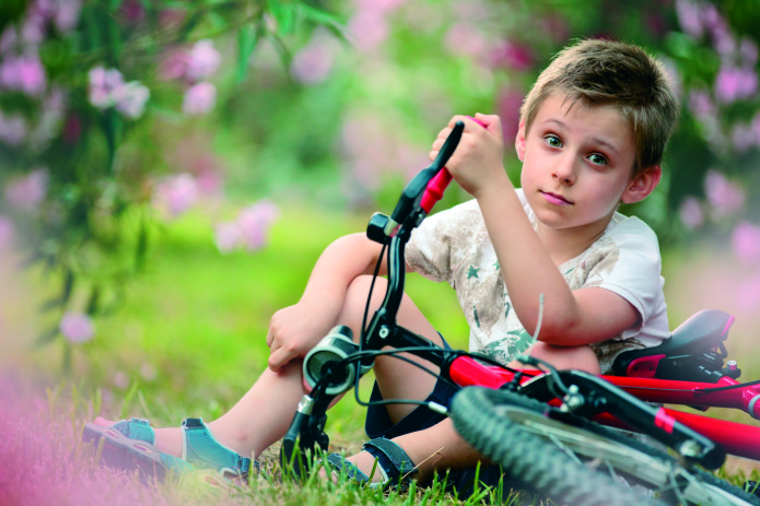 Boy and bicycle.