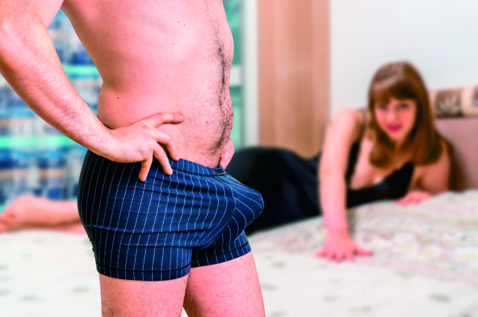 Woman in bed and man in underwear with big penis inside