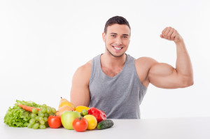 Attractive young fit man prefers healthy food